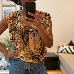 100% Silk Animal print blouse with drop back